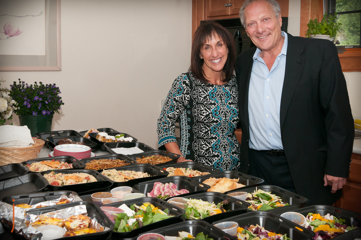 Dyanne Holt, owner of Apollo Grill, with Bob Agentis at the St Luke's Hospice House.