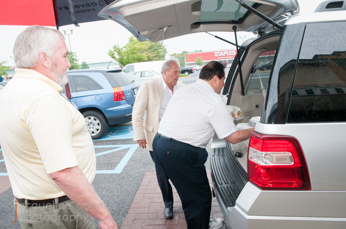 Bob Agentis, Chris Vallianatos, and Tom Long Load Food Donations from The Borderline for the Hospice House