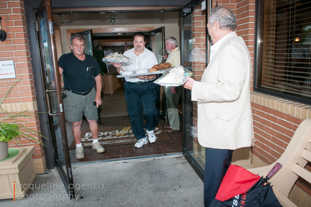 Chris Vallianatos, Bob Agentis, and Tom Long Load SUV with Food Donations for the Hospice House