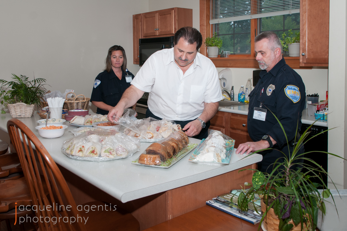 Chris Vallianatos Unwrapping Food Donations for the EMTs at the Hospice House