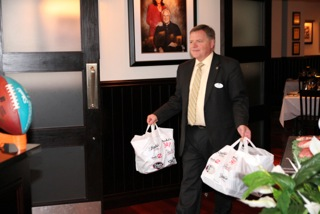 Scott Craver of Shula's Steakhouse donating to the Hospice House