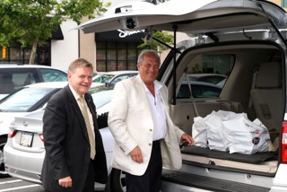 Scott Craver and Bob Agentis loading the SUV at Shula's Steakhouse for donating to the Hospice House