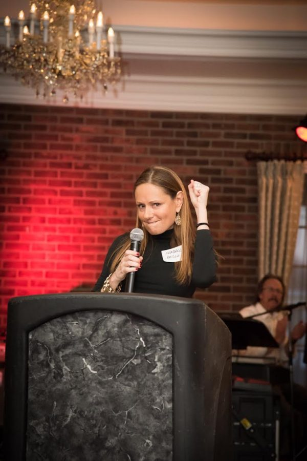 Colon Cancer Survivor Kendall Bello of Bucks County gestures triumph and thankfulness after her speech.